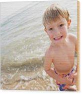 A Smiling Young Boy Enjoys A Sunny Wood Print