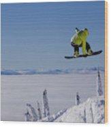 A Snowboarder Catches Air Off A Jump Wood Print