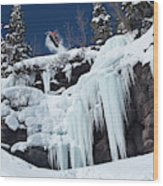 A Snowboarder Jumps Off An Ice Wood Print