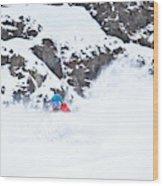 A Snowboarder Riding Through Powder Wood Print
