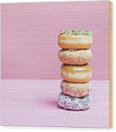 A Stack Of Various Donuts Wood Print