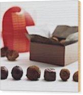 A Still Life Photo Of Gourmet Chocolates Wood Print