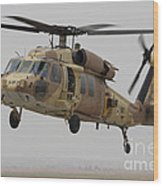 A Uh-60l Yanshuf Helicopter Landing Wood Print