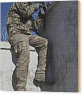 A U.s. Soldier Provides Security At An Wood Print