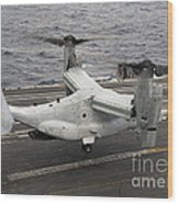 A V-22 Osprey Lands Aboard The Aircraft Wood Print