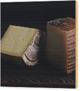 A Variety Of Cheese On A Cutting Board Wood Print