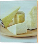 A Variety Of Cheese On A Plate Wood Print