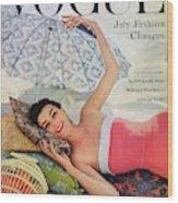 A Vogue Cover Of Anne Gunning Under An Umbrella Wood Print