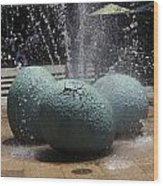 A Water Fountain With Dinosaur Eggs In The Universal Studios Singapore Wood Print
