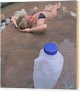 A Water Jug Near A Woman Soaking Wood Print