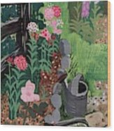 A Watering Can And A Shovel By A Flower Bed Wood Print