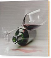 A Wine Bottle And A Glass Of Wine Wood Print