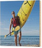 A Woman Carrying Her Sea Kayak Wood Print