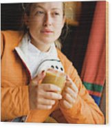 A Woman Enjoys A Warm Cup Of Cocoa Wood Print
