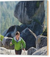 A Woman Hiking High In The Mountains Wood Print