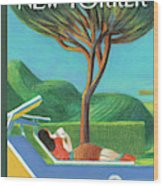 A Woman Lays Outside Under A Tree Reading A Book Wood Print