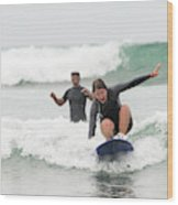 A Woman Learns To Surf Wood Print