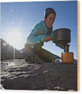A Woman Making Coffee With Portable Wood Print