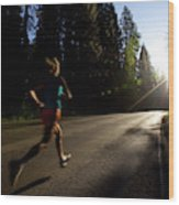 A Woman Running On A Country Road Wood Print