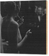 A Woman Smoking At The Music Box Wood Print