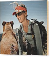 A Woman  Talks To Her Dog While Taking Wood Print