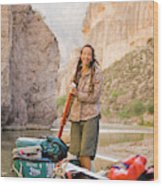 A Woman Unloads Gear From Her Canoe Wood Print