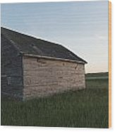 A Wooden Shed In The Middle Of A Grass Wood Print