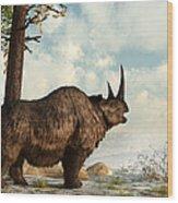 A Woolly Rhinoceros Trudges Wood Print by Daniel Eskridge
