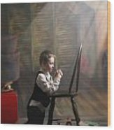A Young Boy Praying With A Light Beam Wood Print