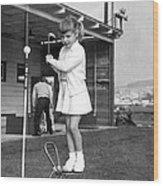 A Young Girl Hits A Golf Ball Wood Print