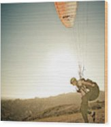 A Young Man Launches His Paraglider Wood Print
