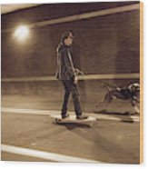 A Young Man On A Skateboard Is Pulled Wood Print