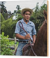 A Young Man Sits On A Horse And Smiles Wood Print