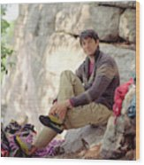 A Young Rock Climber Puts On A Climbing Wood Print