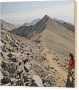 A Young Woman Hikes Borah Peak Wood Print