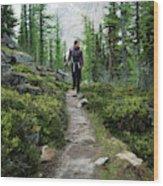 A Young Woman Walks Along An Sub-alpine Wood Print