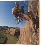 Adventure Racer Rappelling Over A River Wood Print