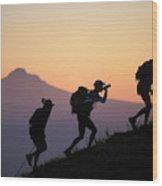 Adventure Racing Team Hiking At Sunset Wood Print