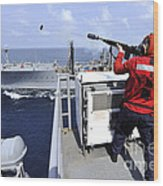 Airman Fires A Shot Line From Uss Wood Print