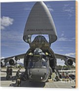 Airmen And Soldiers Load A Ch-47 Wood Print by Stocktrek Images