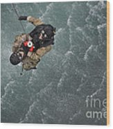 Airmen Are Hoisted Out Of The Water Wood Print