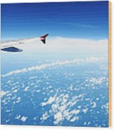 Airplane Wing Against Blue Sky Horizon Wood Print by William Voon
