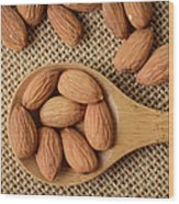 Almonds On A Spoon With Brown Background Wood Print