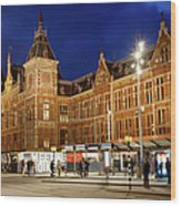 Amsterdam Central Station And Tram Stop At Night Wood Print