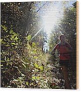 An Adult Woman Trail Running Wood Print