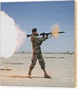An Afghan National Army Soldier Fires Wood Print by Stocktrek Images
