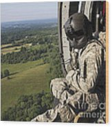 An Army Crew Chief Looks Out The Door Wood Print