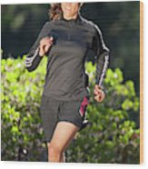 An Athletic Woman Trail Running Wood Print