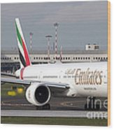 An Emirates Boeing 777 At Milano Wood Print