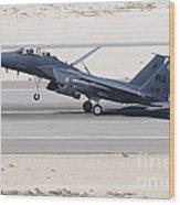 An F-15c Eagle Landing On The Runway Wood Print